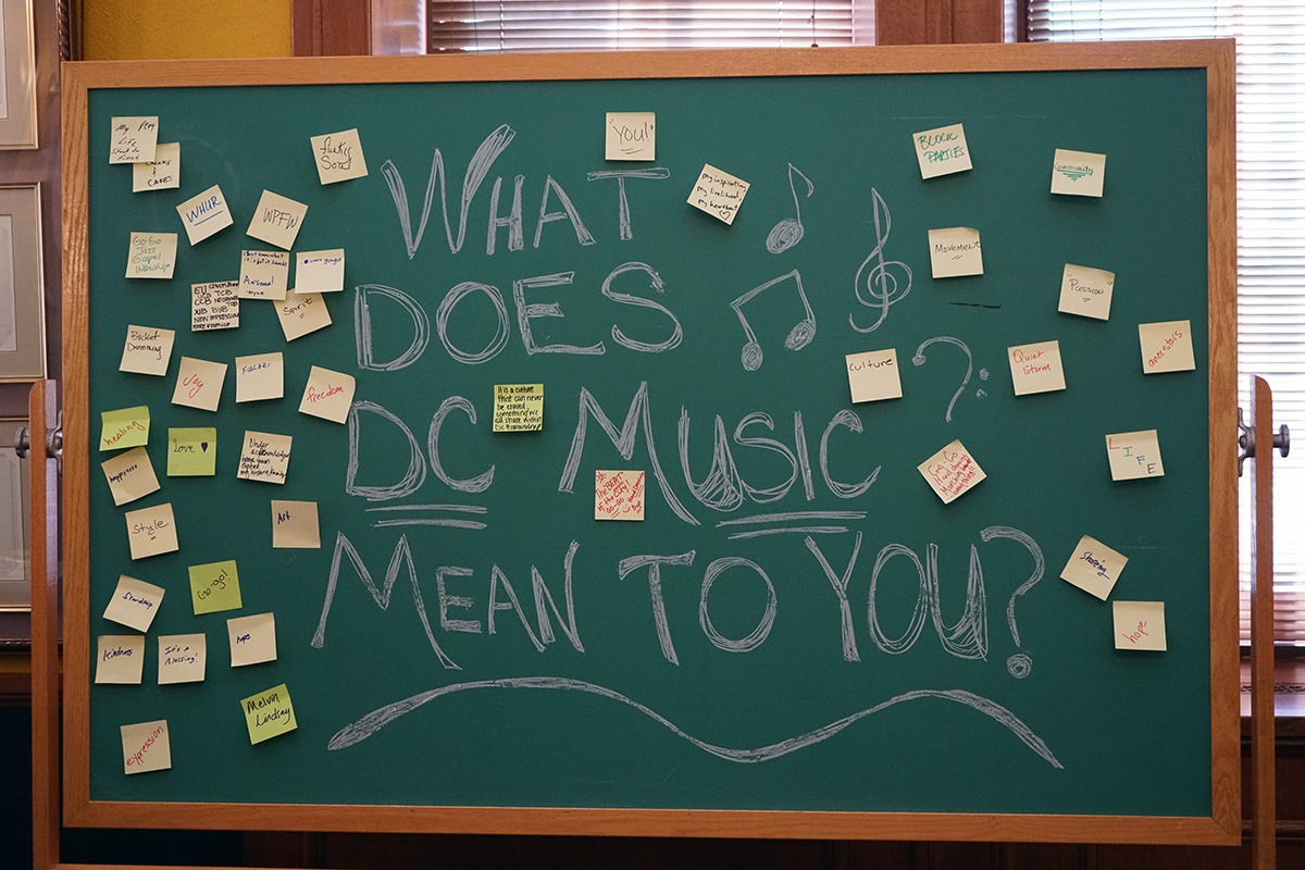 "A chalkboard at the panel discussion asks, ""What does D.C. music mean to you?"" Visitors responded on Post-It notes."
