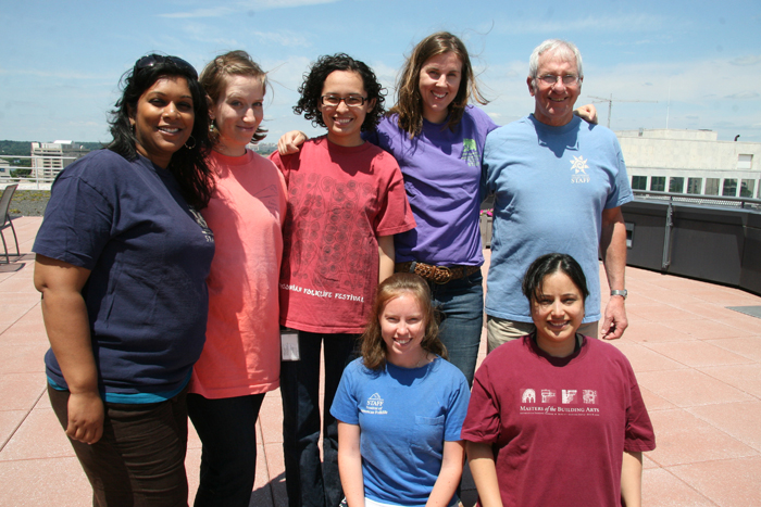 Reshma, Laura, Diana, Meredith, Arnie, Anna and Jeanette model past Festival shirts.