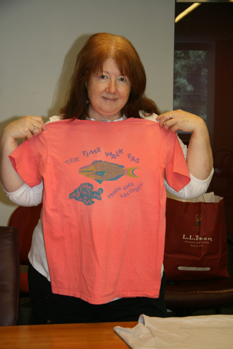 Claudia Telliho loves this shirt because its bright colors capture the spirit of that particular Festival year.