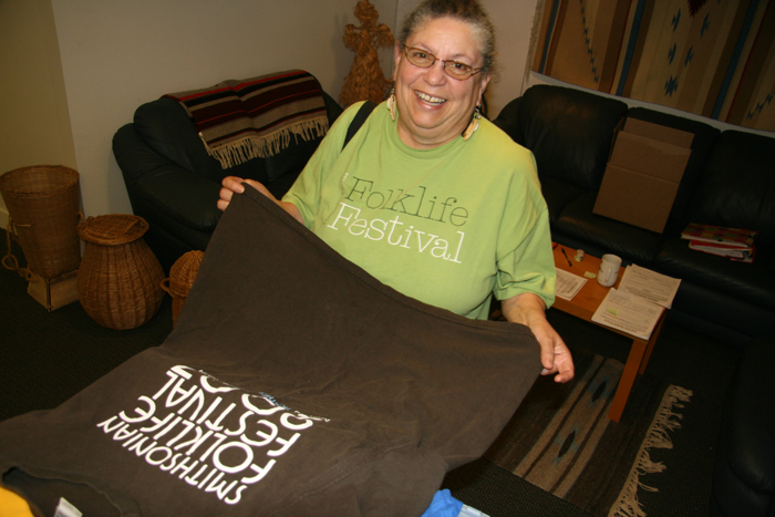 Pam Rogers and her favorite text-based Festival T-shirts.