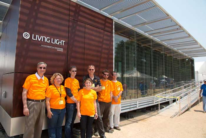 University of Tennessee participants show off their solar-powered house, which draws its design inspiration from Appalachia's traditional cantilever barns. Photo by Francisco Guerra, Smithsonian Institution