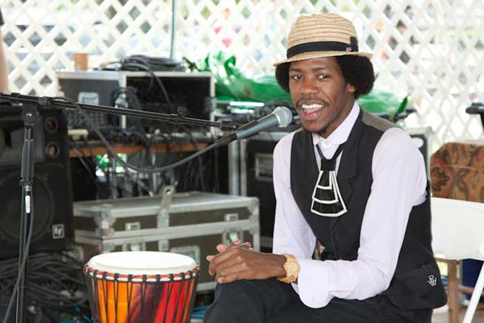 "Christylez Bacon shows off his multi-instrumental talents in the ""Citified"" program. Photo by Jane Cave, Smithsonian Institution"
