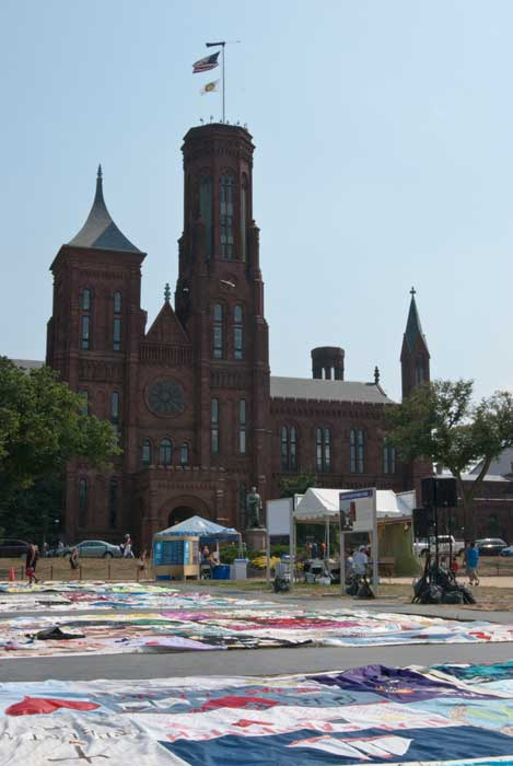 View of The AIDS Memorial Quilt with the Smithsonian castle in the background. Photo by Josh Weilepp, Smithsonian Institution