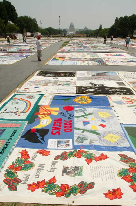 Visitors make their way across the landscape of The AIDS Memorial Quilt. Photo by Robert Friedman, Smithsonian Institution