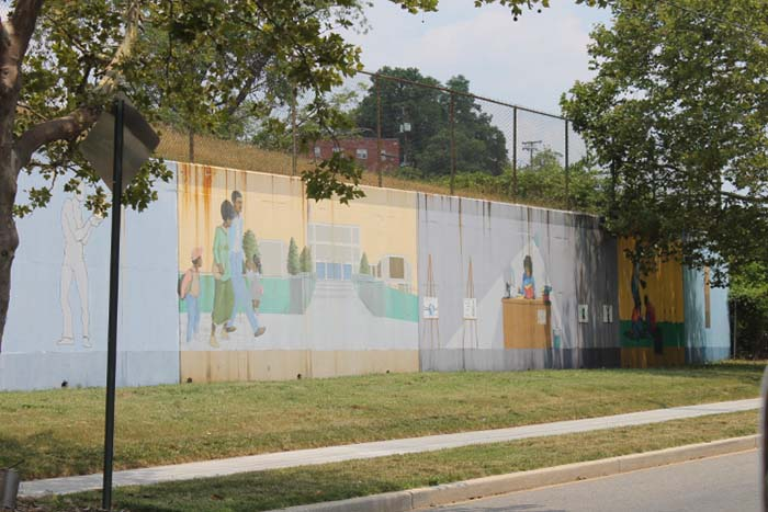 This older mural is located on Mississippi Avenue. The faded colors and rust stains show signs of aging, but they do not diminish the importance of education depicted.