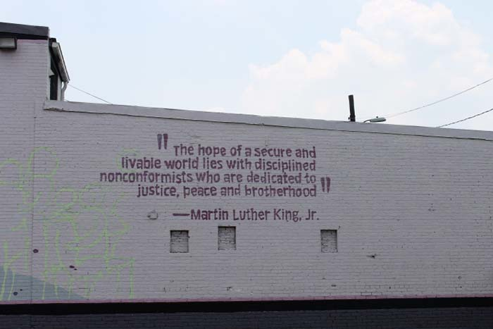 Farther down on the same wall is a quote from Martin Luther King, Jr., which articulates the themes of the mural.