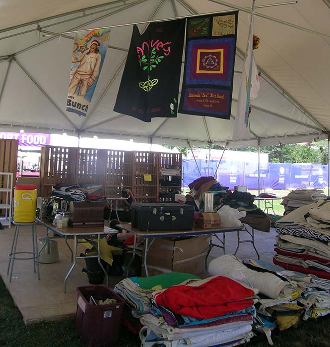 Quilting material and fabric swaths are stacking up in the <em>Creativity and Crisis</em> program tents.