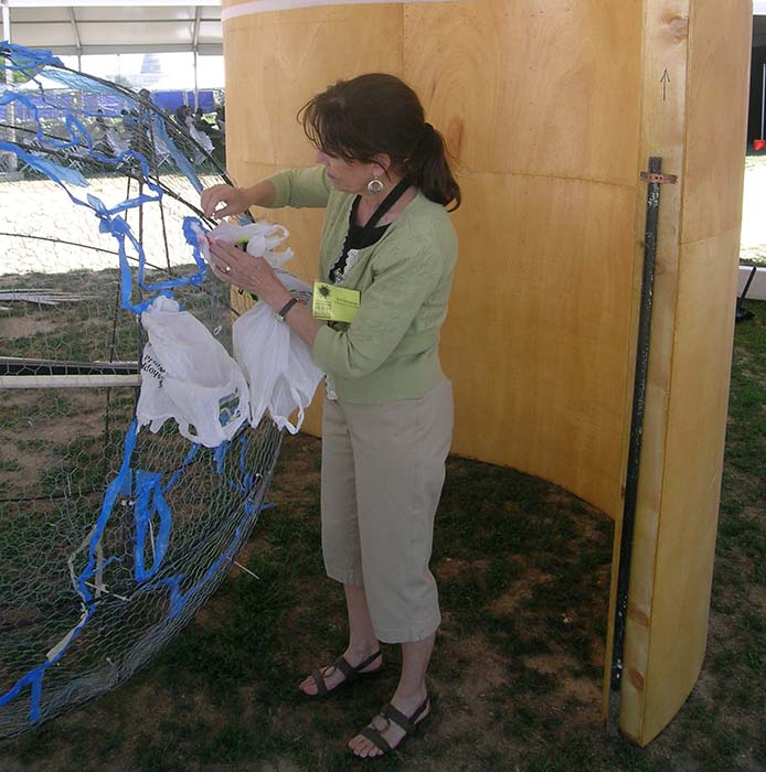 Design Professor Ann Savageau from the University of California at Davis works on the BAG installation.