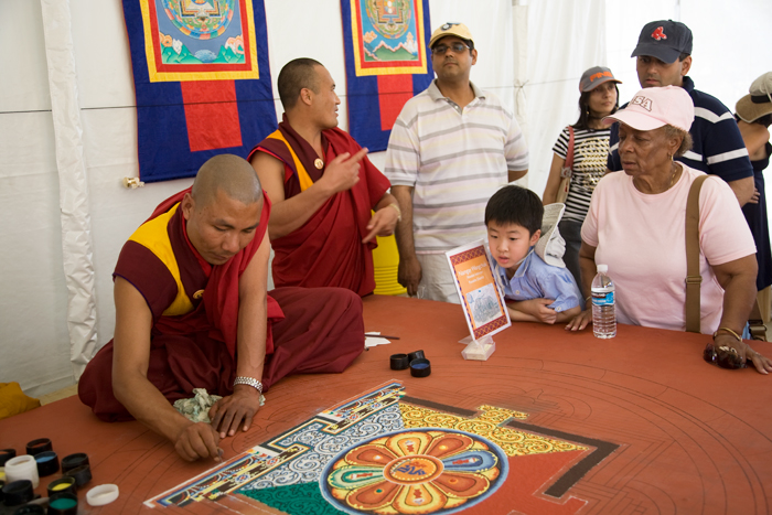 Namgay Wangchuk from the Punakha District works on a mandala for visitors in the <i>Bhutan</i> program at the 2008 Festival.