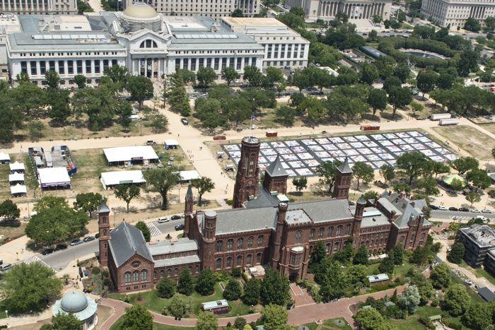The 2012 Festival featuring the AIDS Memorial Quilt on the National Mall is flanked by the Smithsonian Castle and the National Museum of Natural History.
