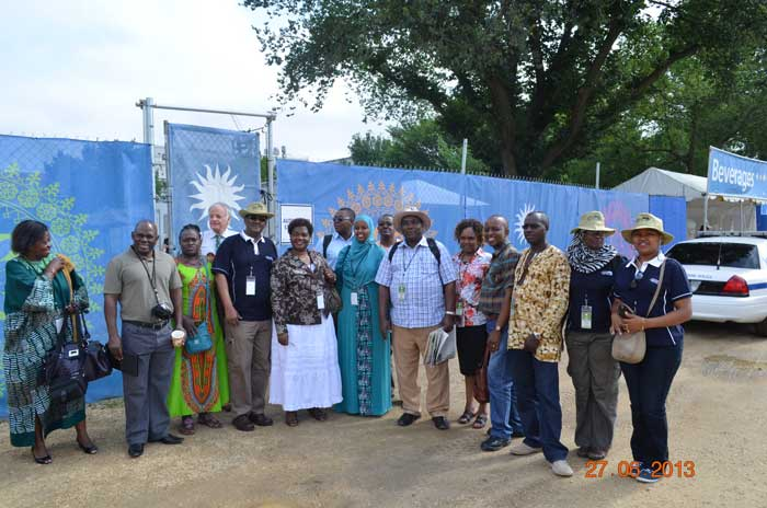 The delegation stands outside the Folklife Festival staff compound before touring the site and programs. Photo courtesy of the Kenya Cultural Centre