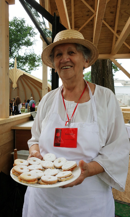 Ilona Kollár smiles as she offers vanilla wreaths with apricot jam. Photo by Lili A. Kocsis