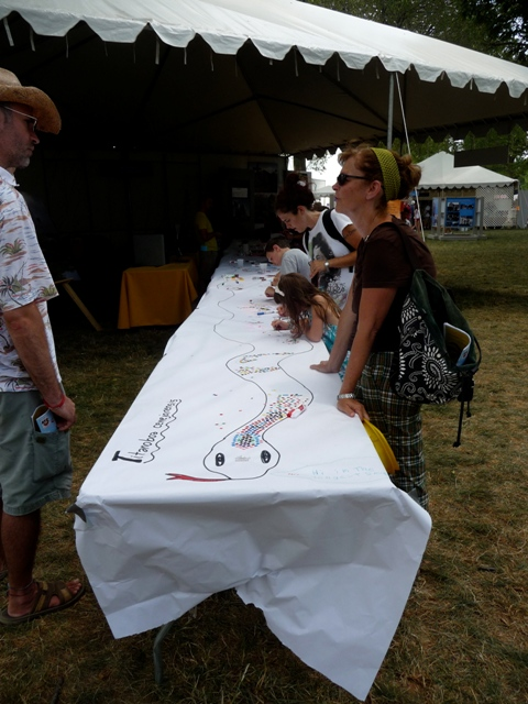 It took seven tables to accommodate the length of the forty-three-foot fossil snake at the Folklife Festival.