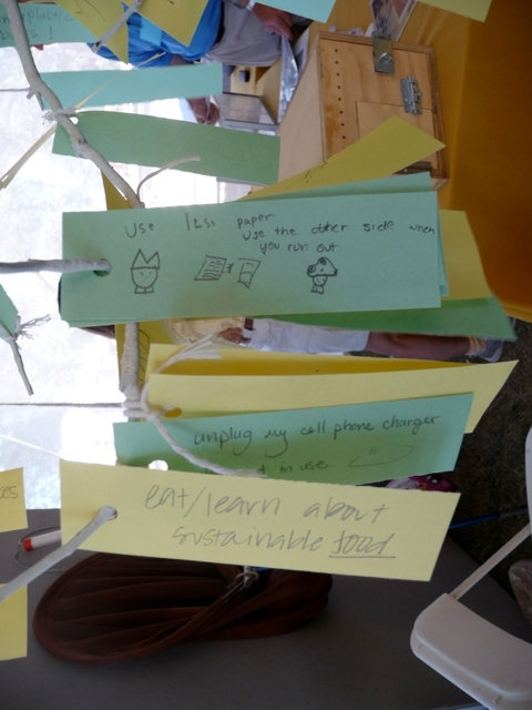 Visitors leave suggestions for sustainable actions at the Smithsonian and in their own lives on a Sustainability Tree in the Tending and Mending tent of the Smithsonian Inside Out program.