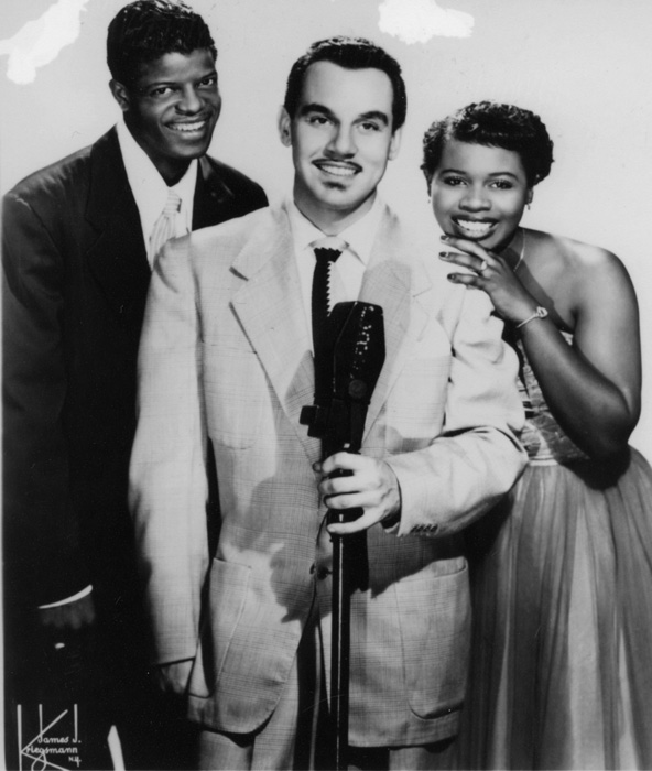 "Johnny Otis (center) with Mel Walker and ""Little"" Esther Phillips, ca. late 1940s. Photo by James J. Kriegsmann, courtesy of Indiana University Archives of African American Music and Culture, Jack Gibson Collection"