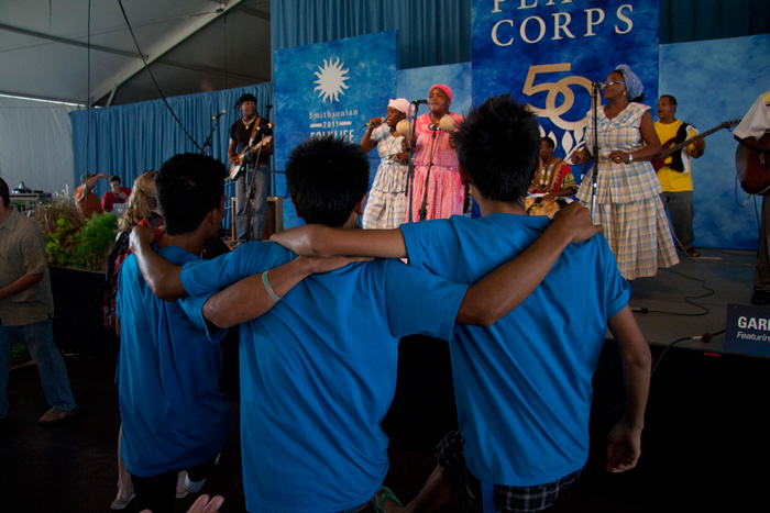 Audience members dance to the Garifuna Collective and Umalali.