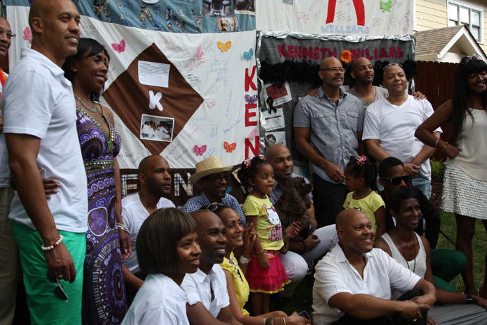 The community of friends gathers in front of the block they made for Kenny Williams.