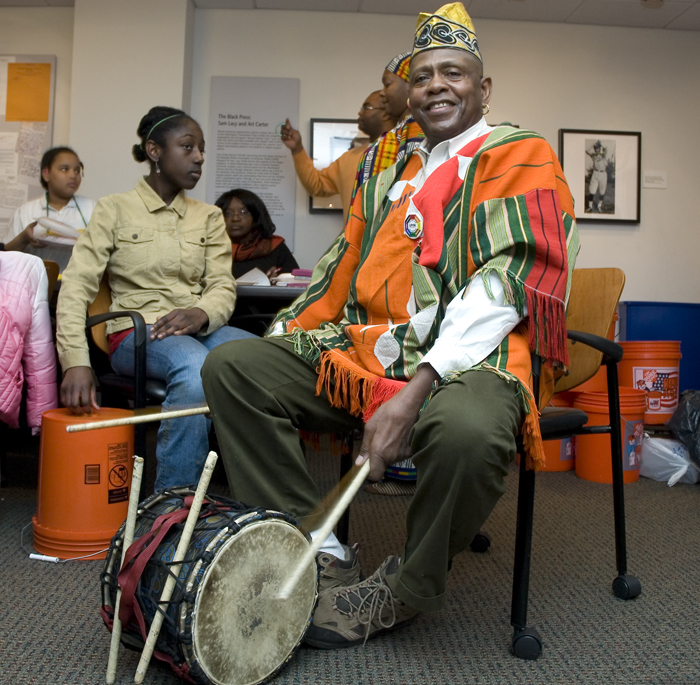 Melvin Deal performs during a Kwanzaa celebration at the Anacostia Community Museum.