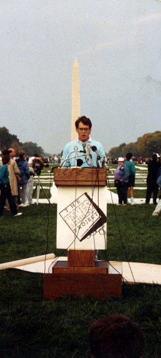 Cleve Jones, one of the founders of The AIDS Memorial Quilt, reads names at the 1987 Quilt display in Washington, D.C.