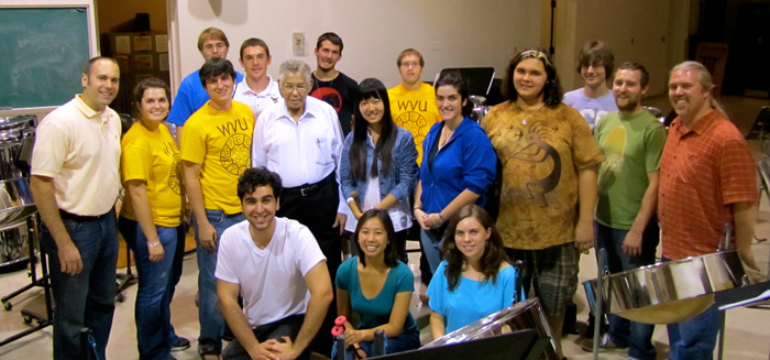 WVU steel drum master Ellie Mannette, white shirt, center, poses with some of his West Virginia University ensemble students.