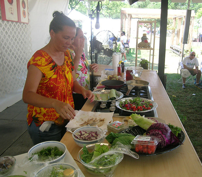 Ilima Ho-Lastimosa and Leinaala Bright demonstrate the preparation of traditional Hawaiian cuisine.