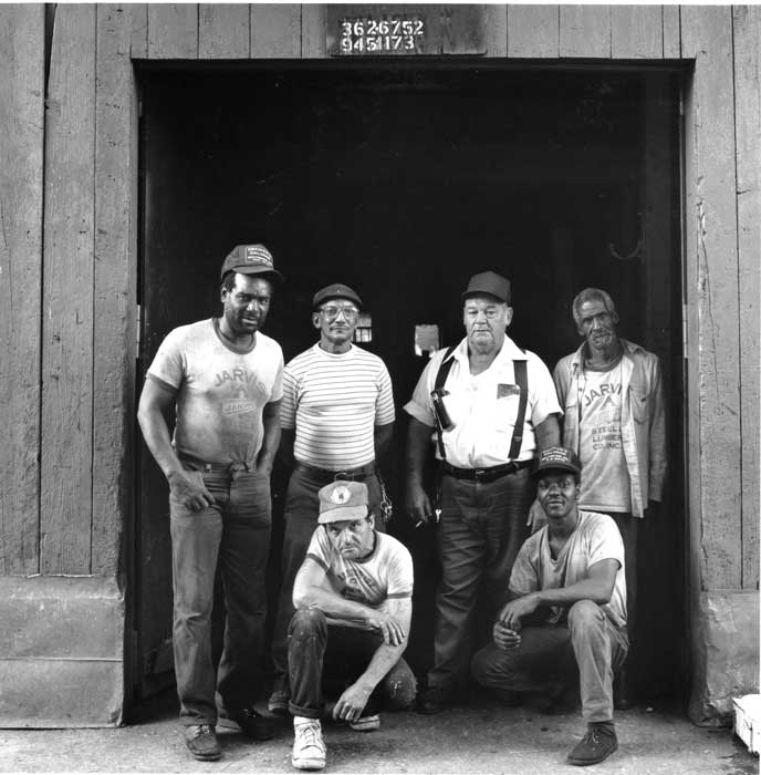 "Arabbers at the Kratz stable, Southwest Baltimore, Maryland, June 1986. From left to right: Caroll ""Tomboy"" Hughes, Walter ""Teeth"" Kelly, Walter ""Buddy"" Kratz, William ""Eastern Jim"" Fields, Robert ""Porky"" Warner, and ""Mandyman."" This stable was built by Charlie Boyle around 1899. It is located on Lemmon Street, between Pratt and Lombard Streets off South Carlton Street. Photo © 2012 Roland L. Freeman"