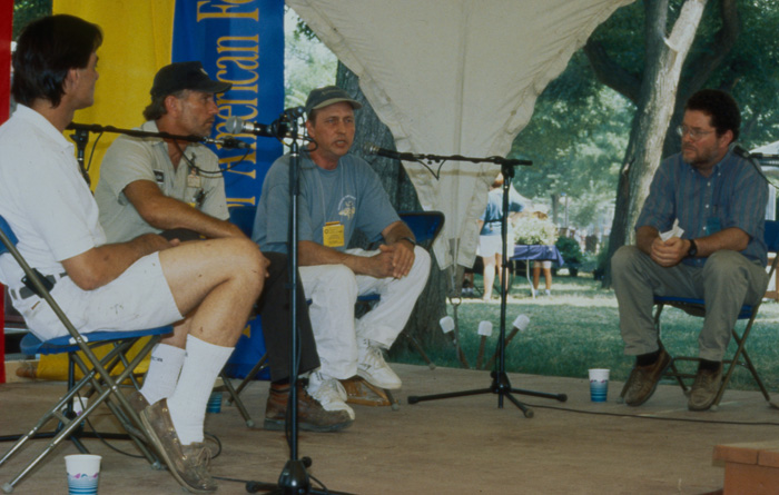 "Peter Seitel moderates a conversation on the narrative stage of the 1996 ""Working at the Smithsonian"" Festival program."
