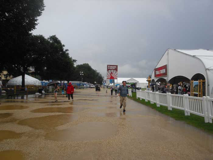 Rain falls on the National Mall on June 28, 2013, day 3 of the 2013 Smithsonian Folklife Festival. Photo by Sojin Kim