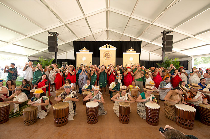 Dancers and musicians in hula group UNUKUPUKUPU perform in the Opening Ceremony of the 2012 Smithsonian Folklife Festival. Photo by Walter Larrimore, Ralph Rinzler Folklife Archives
