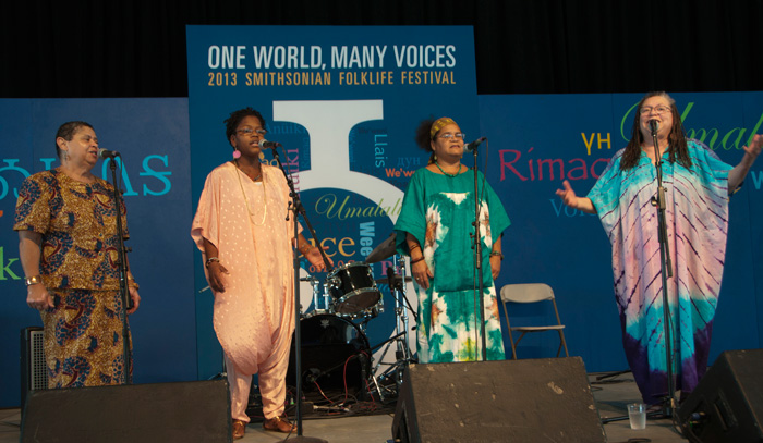 Members of D.C.-area a capella group In Process… perform at the Voices of the World stage on the first night of the 2013 Smithsonian Folklife Festival. Photo by Joe Furgal, Ralph Rinzler Folklife Archives