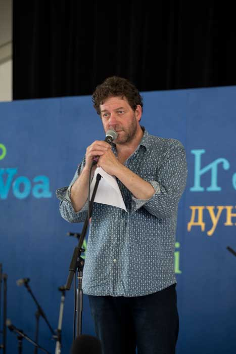 Welsh poet and singer Twm Morys at the <i>Voices of the World</i> stage, 2013 Folklife Festival. Photo by Maggie Pelta-Pauls, Ralph Rinzler Folklife Archives