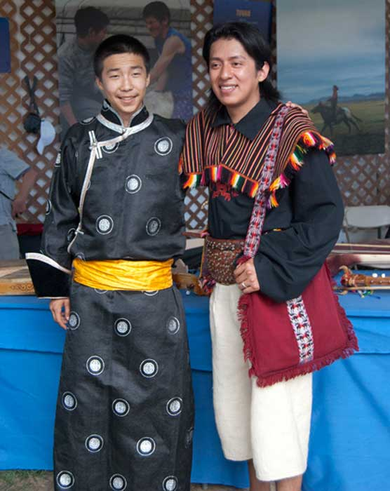 A musician from the Tuvan delegation and a member of Los Masis from Bolivia pose in the <i>One World, Many Voices</i> program area. Photo by Beatrice Ugolini, Ralph Rinzler Folklife Archives