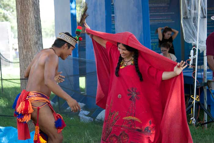 Wayuu dancer Marciano Urrariyú Gouriyu from Colombia and Festival presenter Maria Firmino-Castillo perform a traditional dance in the <i>One World, Many Voices</i> program area. Photo by Katherine Moore, Ralph Rinzler Folklife Archives