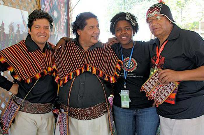 Arlean Dawes with three members of Los Masis—(L to R) Roberto Sahonero Cuéllar, Roberto Sahonero Gutiérrez, and Edgar Sahonero Gutiérrez—in the <i>One World, Many Voices</i> program. Los Masis is a group of Bolivian musicians and educators dedicated to preserving the Quechua language and indigenous Andean culture. Photo by Patti Heck
