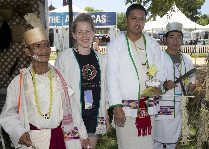 Anne Pedersen poses with Koro participants (L to R) Ramda Degio, Bhokta Newar, and Sange Mijew in the One World, Many Voices: Endangered Languages and Cultural Heritage program. Photo by Francisco X. Guerra, Ralph Rinzler Archives and Collections, Smithsonian Institution