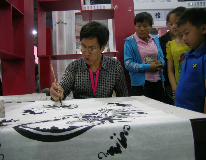 A brush painter demonstrates his work for children at an exposition in Taierzhuang, China.