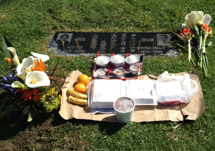 A food offering and picnic at Rose Hills Memorial Park in Whittier, California.