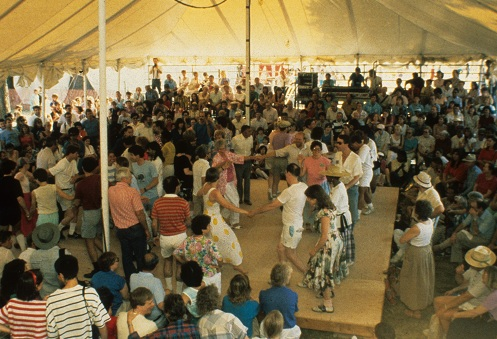 Visitors and participants dancing at the 1989 Folklife Festival.