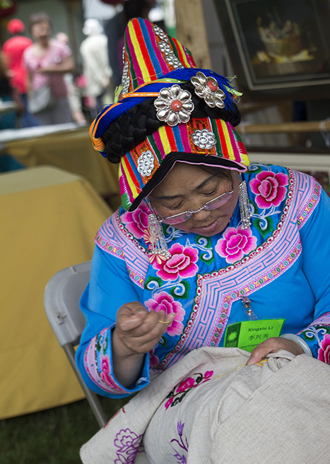 Xingxiu Li demonstrates Qiang embroidery from Sichuan Province.