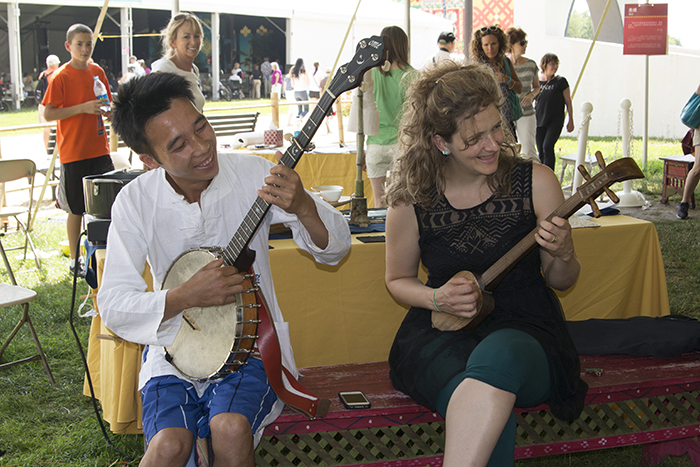 Abigail Washburn joins an impromptu jam in the China Textiles tent.