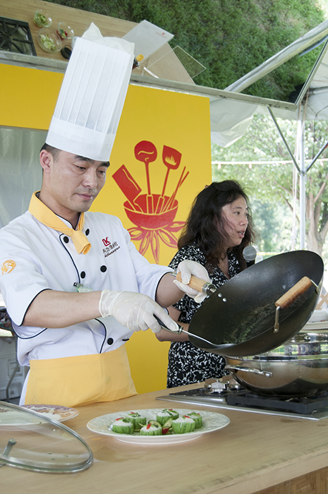 A foodways demonstration in China's Five Spice Kitchen.