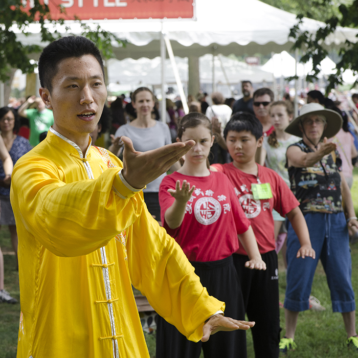 Chai Yunlong leads a tai chi demonstration in People's Park.