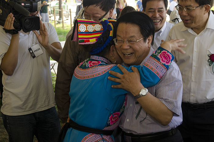 Chinese Minister of Culture Cai Wu embraces Qiang embroiderer Xingxiu Li during a tour through the China program.