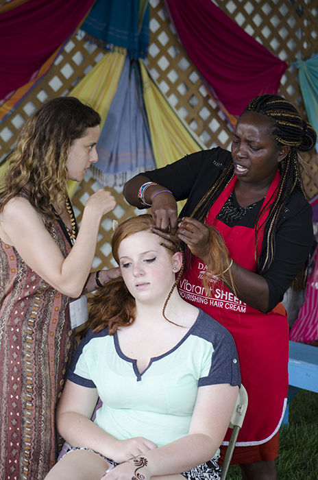 Hair braiding in Kenya's Adornment Arts tent.
