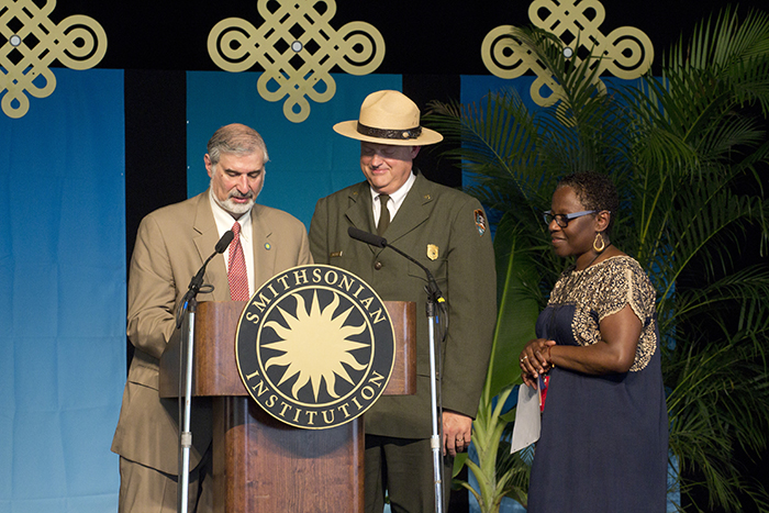Richard Kurin (under secretary of History, Art, and Culture at the Smithsonian), Robert Vogel (superintendent of National Mall and Memorial Parks at the National Park Service), and Sabrina Motley (director of the Smithsonian Folklife Festival) prepare to sign a memorandum of understanding that ensures the Festival's future on the National Mall.