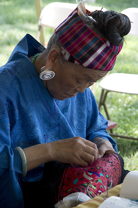 Pan Yuzhen demonstrates Miao embroidery.