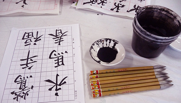 Practicing calligraphy. Photo by Betty Belanus