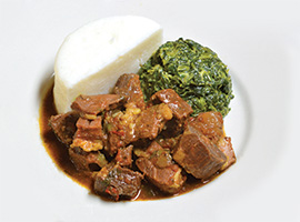Goat stew with spinach and ugali. Photo by and courtesy of Swahili Village