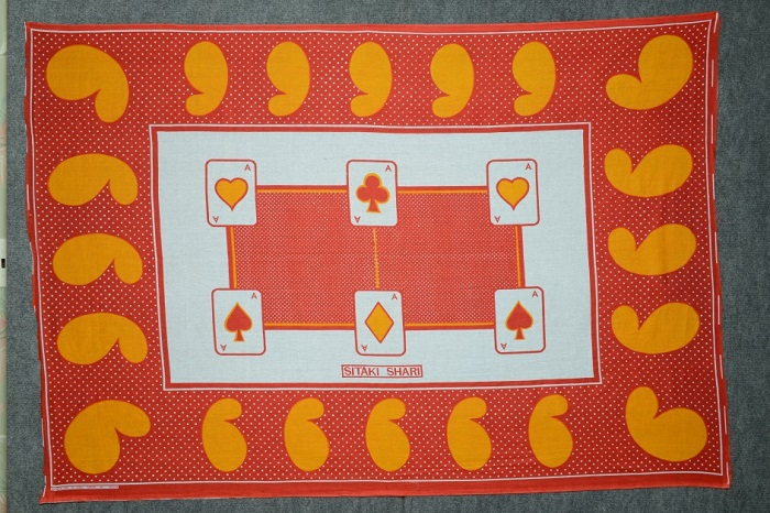 "This traditional khanga features the popular cashew shape on its border, as well as a text message, which means ""I do not want evil"" in Kiswahili. Photo by and courtesy of Howard Zehr"