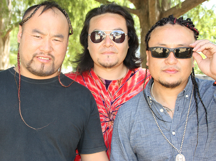 Some members of the Inner Mongolian band Ih Tsetsn visited the adornment tent to get their hair braided.
